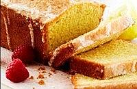 Lemon drizzle cake with fresh raspberry cream sauce