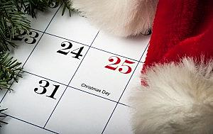 Santa hat laying on a Christmas calendar