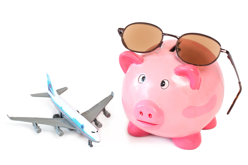 Piggy bank with sunglasses and toy plane