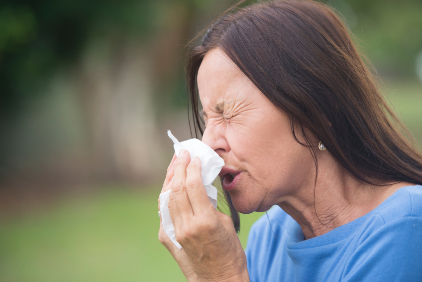 Sick mature woman suffering flu or hayfever