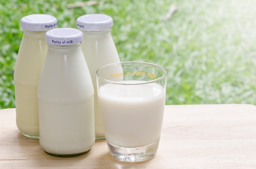 Bottles of fresh milk on table
