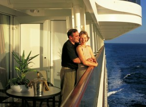 Couple on the verandah of a cruise ship